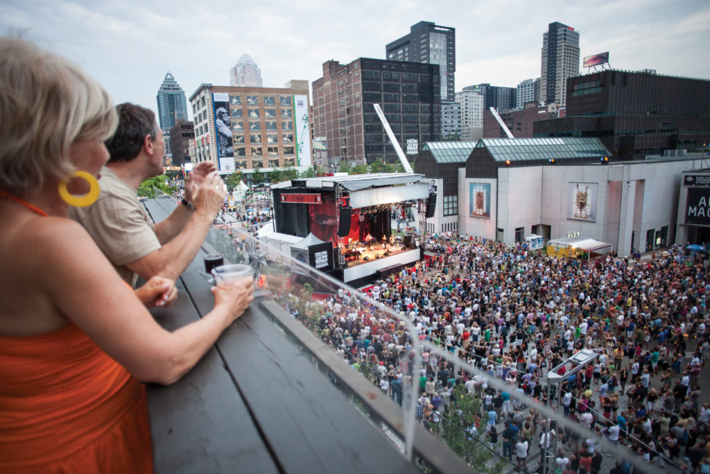 Montreal Jazz Fest crowds enjoying free concerts in the city.