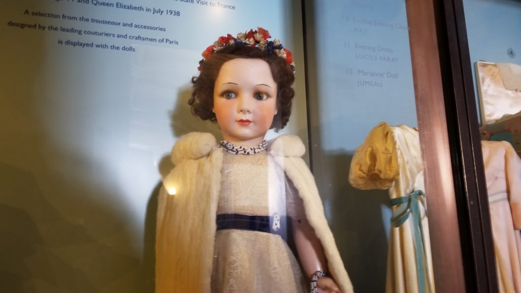 Queen Elizabeth's doll was dressed by famous French couturiers and wears a real ermine stole.