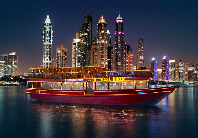 traditional dhows cruise the Dubai harbor