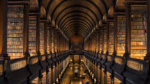 Couple visiting the Long Room at Trinity College, Dublin