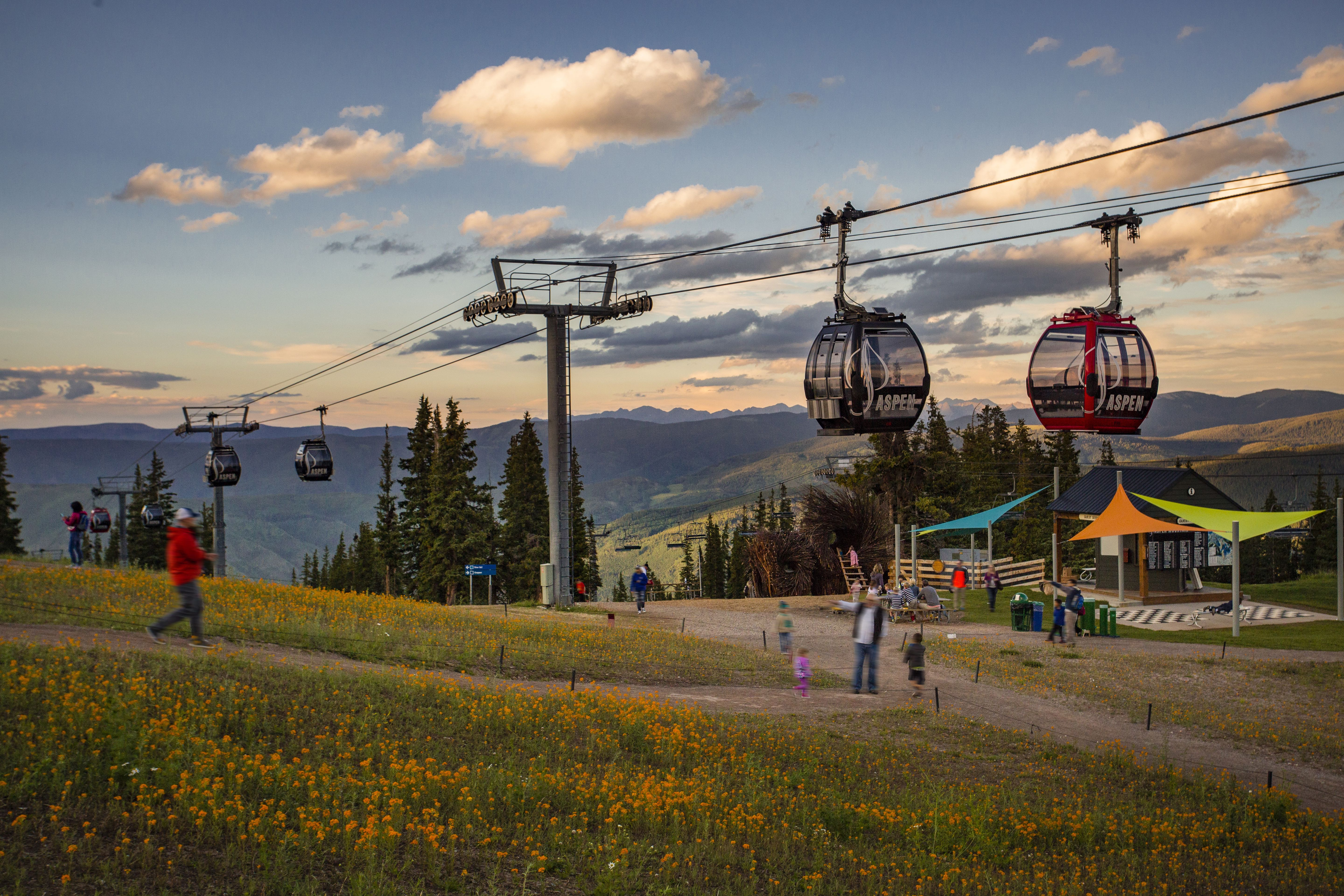 Gondolas arrive at peak of Aspen Mountain in Fall
