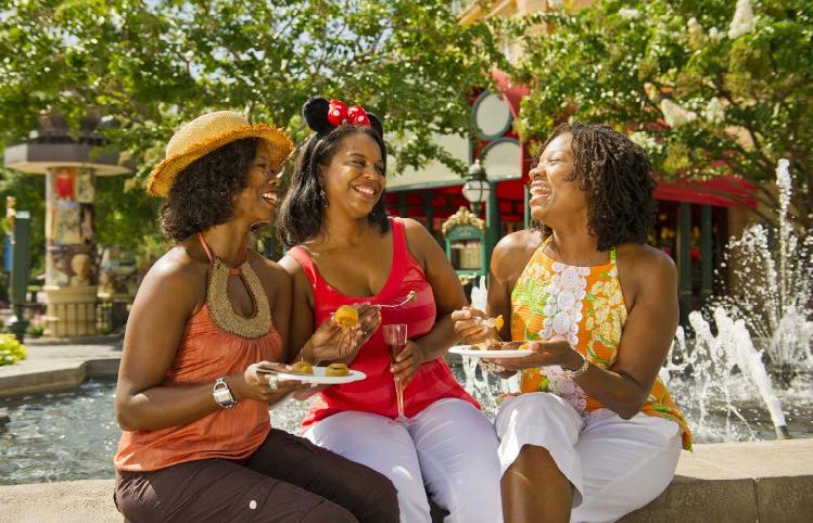 Girlfriends meet at Epcot's International Food & Wine Festival, Walt Disney World.