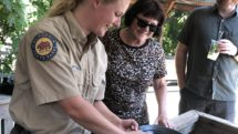 Park ranger demonstrates gold panning to guests at Marshall Gold Discovery State Park in Coloma.