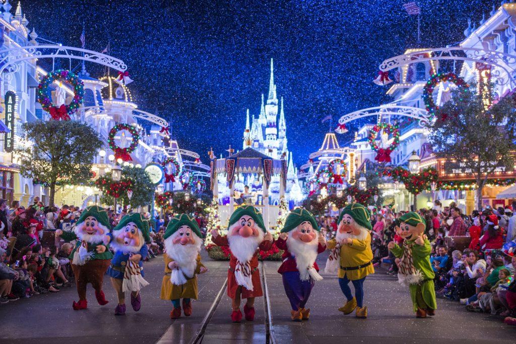 The Seven Dwarfs parade through Magic Kingdom