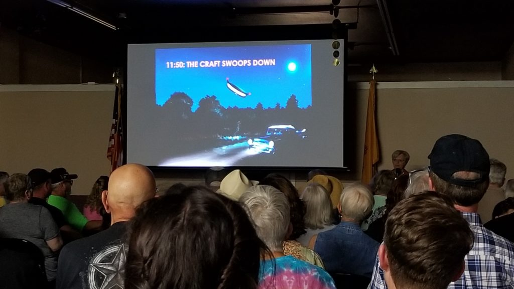 The audience at the Internationl UFO Museum is captivated by a presentation on the Betty and Barney Hill Abduction from 1961.