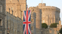 Windsor Castle with the British flag welcoming visitors.
