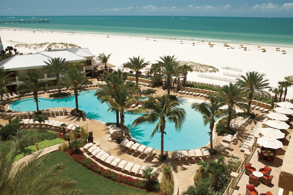 The Sandpearl resort boasts a lagoon pool right along the beautiful white sand beach of Clearwater, Florida.