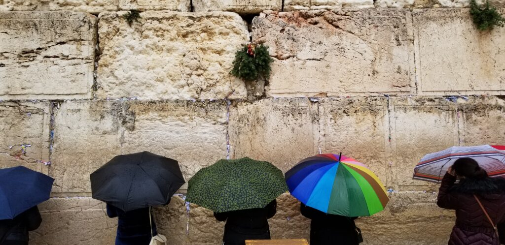 Visitors come to the Western Wall to pray and place notes inside the wall's cracks