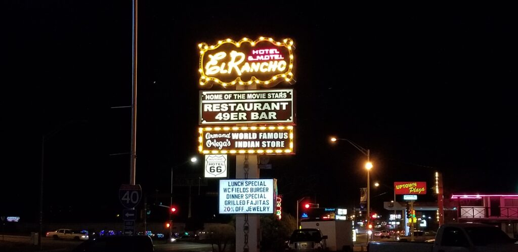 The flashing neon sign of the El Rancho Hotel Motel