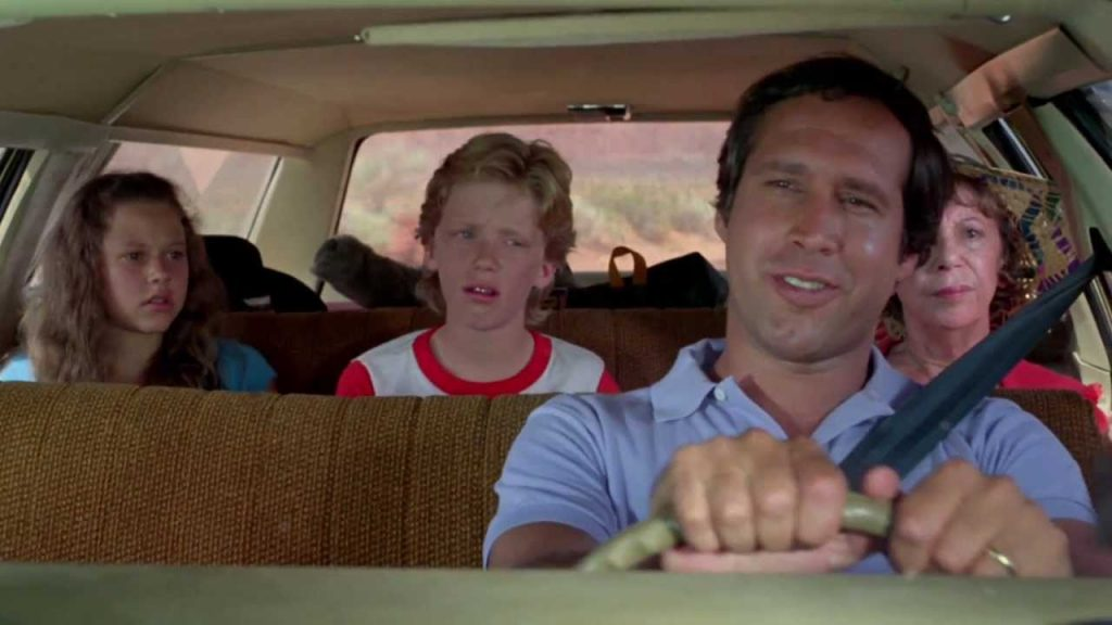 "Chevy Chase in car for ""Animal House Vacation."""
