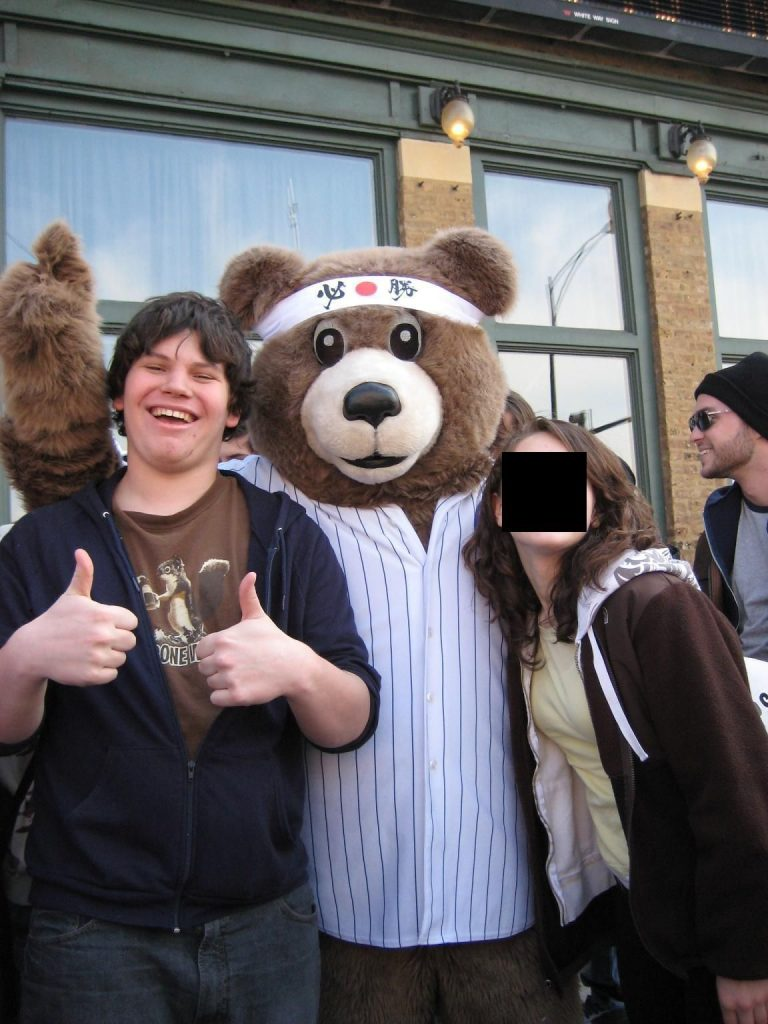Boy with bear mascot