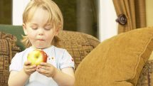 boy holds apple