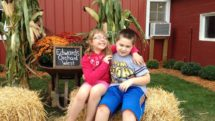 Kids on hay bale at Edwards Orchard, Illinois
