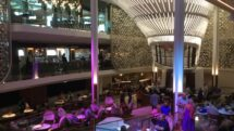 On Celebrity Edge, a three-story atrium surrounded by dining and nightlife