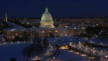 Capitol building in Washington DC at night with snow.