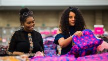 Two shoppers compare finds at the Vera Bradley Outlet Sale.