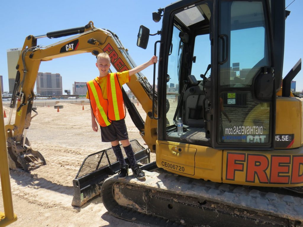 Dig This! guests use heavy construction equipment in a huge Vegas sand box.
