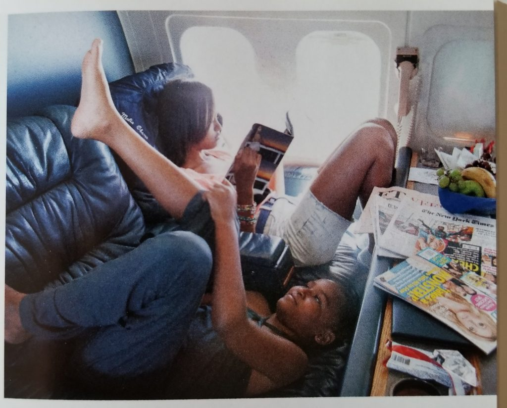 "Sasha and Malia Obama traveling with their mom to work on ""Bright Star"" the First Lady's private plane. Photo from ""Becoming Michelle Obama."""
