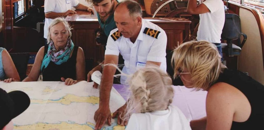 gulet captain shows passengers route