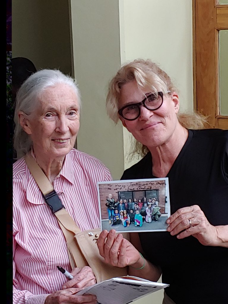 Author presents photo from schoolchildren to Jane Goodall.