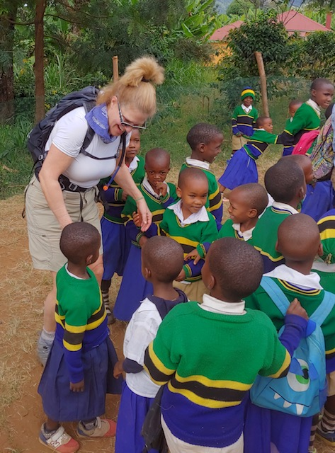 Author visits with school children in Tanzania.