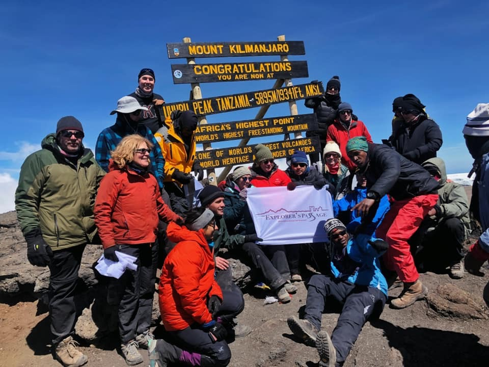 Explorers Passage trekking group reaches summit of Kilimanjaro, Africa's tallest peak.