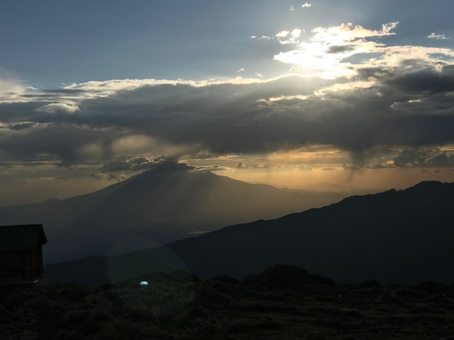 Sunset over the peaks of Africa seen from Mount Kilimanjaro.
