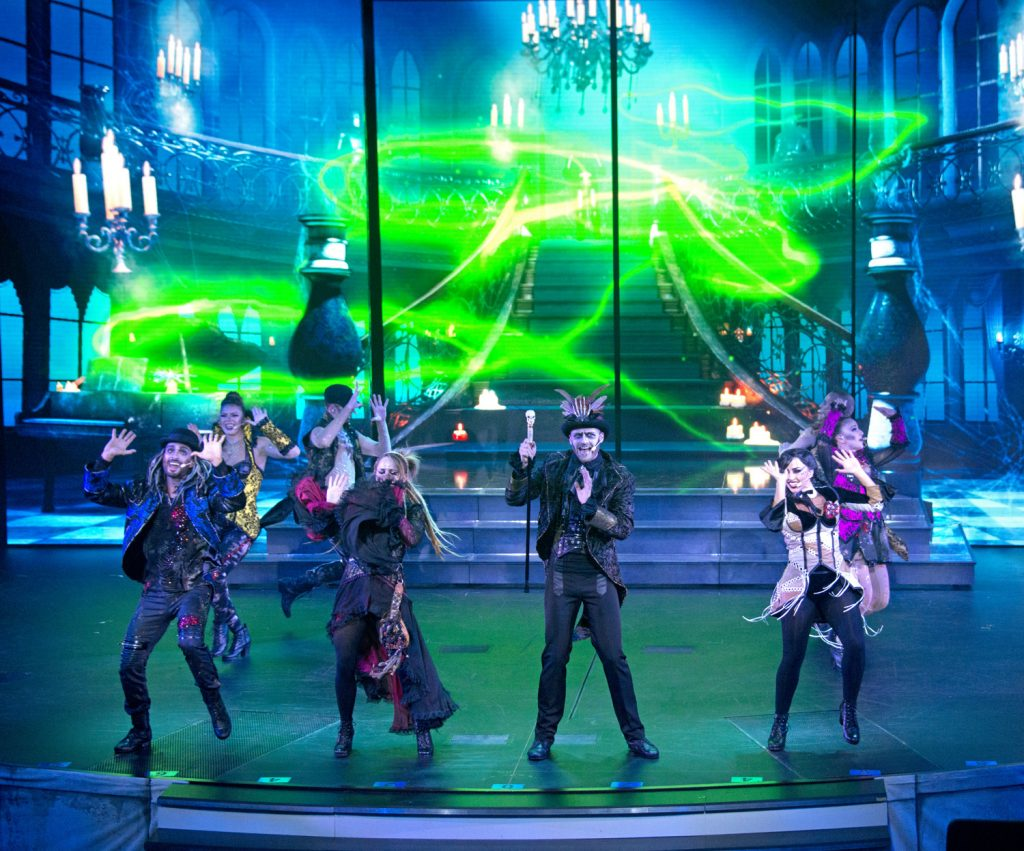 Performers in gothic costumes doing music revue on ship.