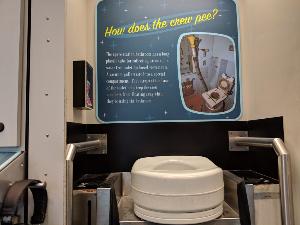 The space exhibit at COSI with a toilet seat