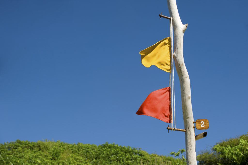 A flag pole is the efficient low-tech message system between staff and guests.