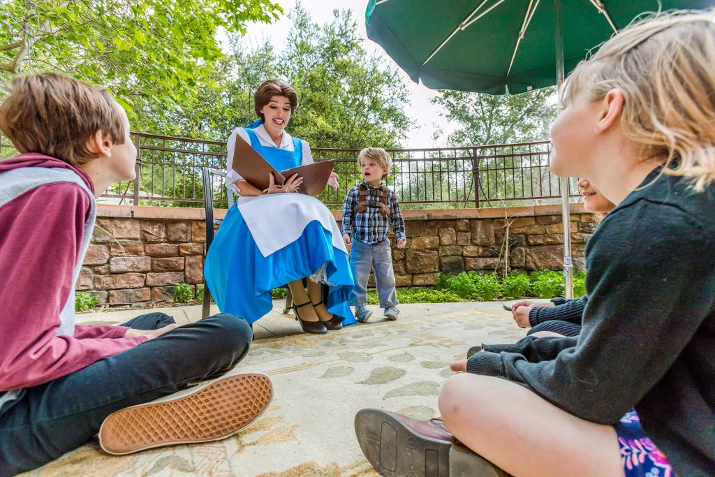 Snow White reads to children at Disneyland Resort character breakfast