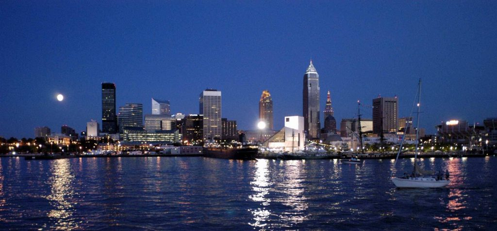 Cleveland at night, glowing above the Lake Erie shore.