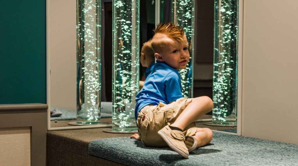 Presley Rudge, inspiration for the Sensory Space at Pittsburgh Airport, explores the peaceful new waiting area.