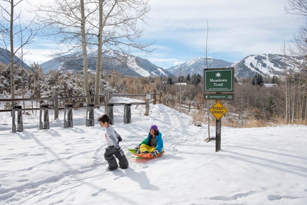 Kids sledding at Aspen Meadows