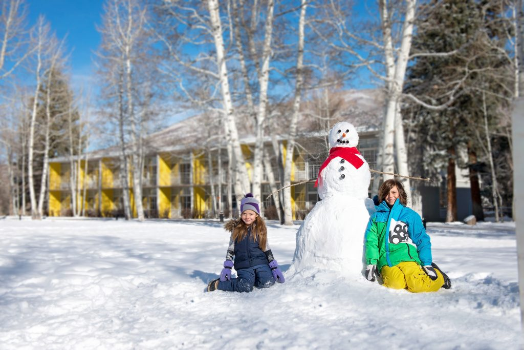 A snowman with kids at Aspen Meadows