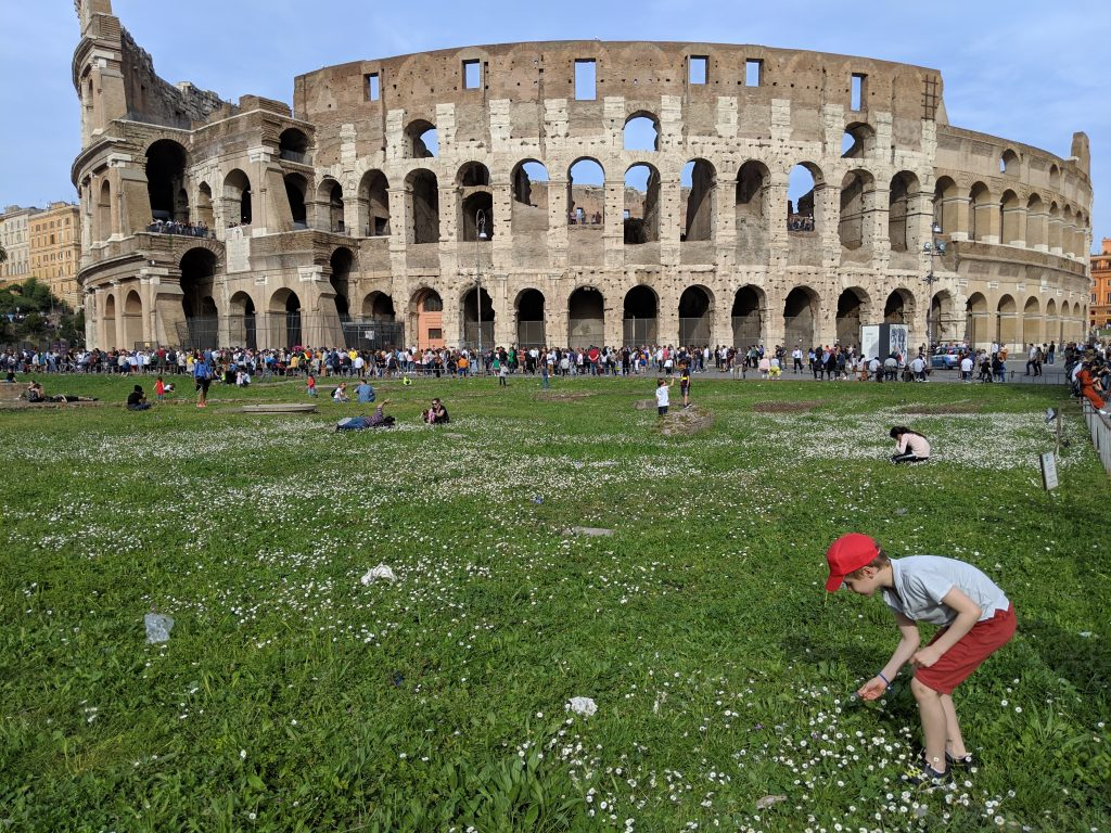 Children on lawn of Colosseum.