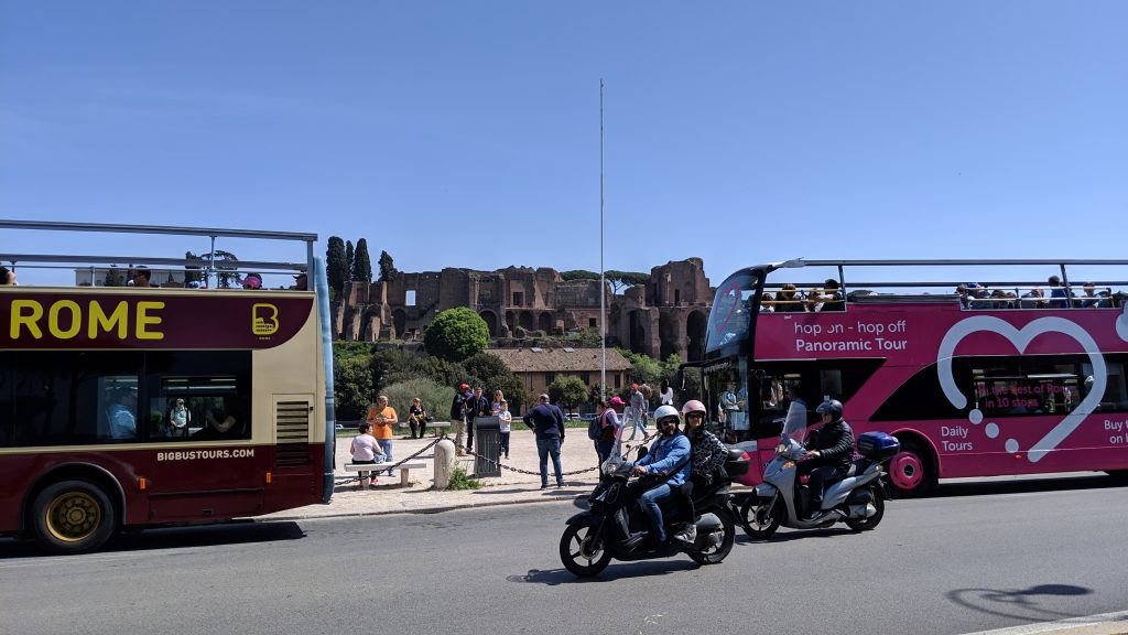 Doubledecker buses stop by Roman Forum.