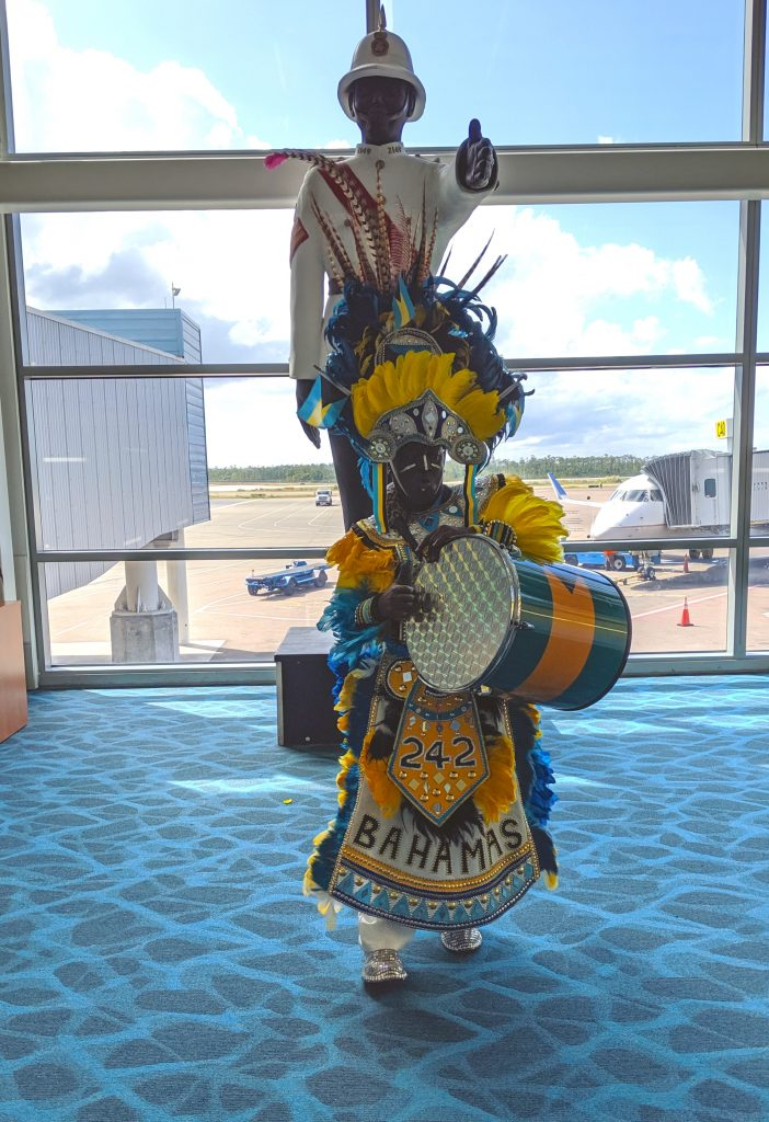 Junkanoo character greets visitors at Nassau Airport.