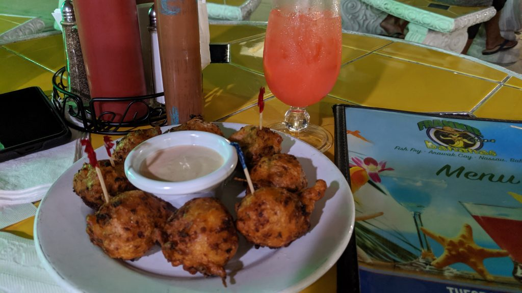 Conch Fritters and a fruit punch at Frankie Gone Bananas in Fish Fry, Arawak Cay.