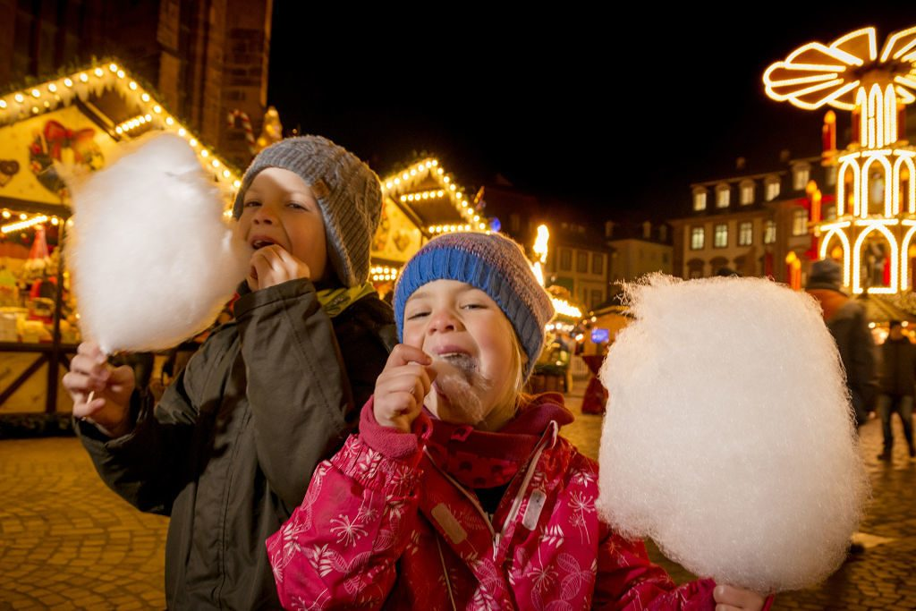 Kids eating cotton candy at Christmas Market