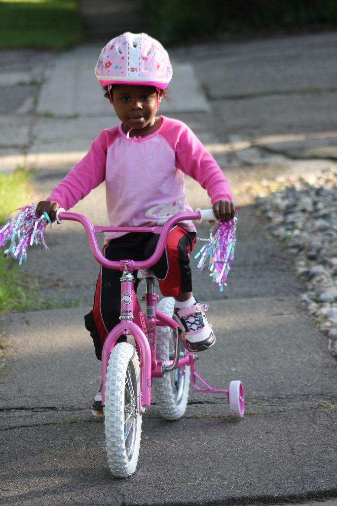 girl on bike with helmet