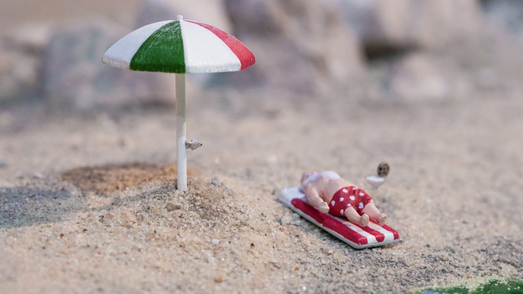 Santa takes a beach break at Gulliver's Gate miniature world display.