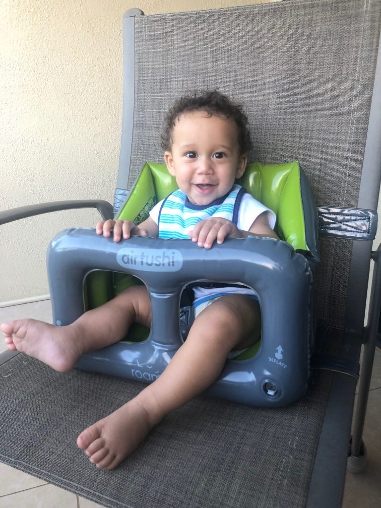 Baby ising the Airtushi portable inflatable high chair