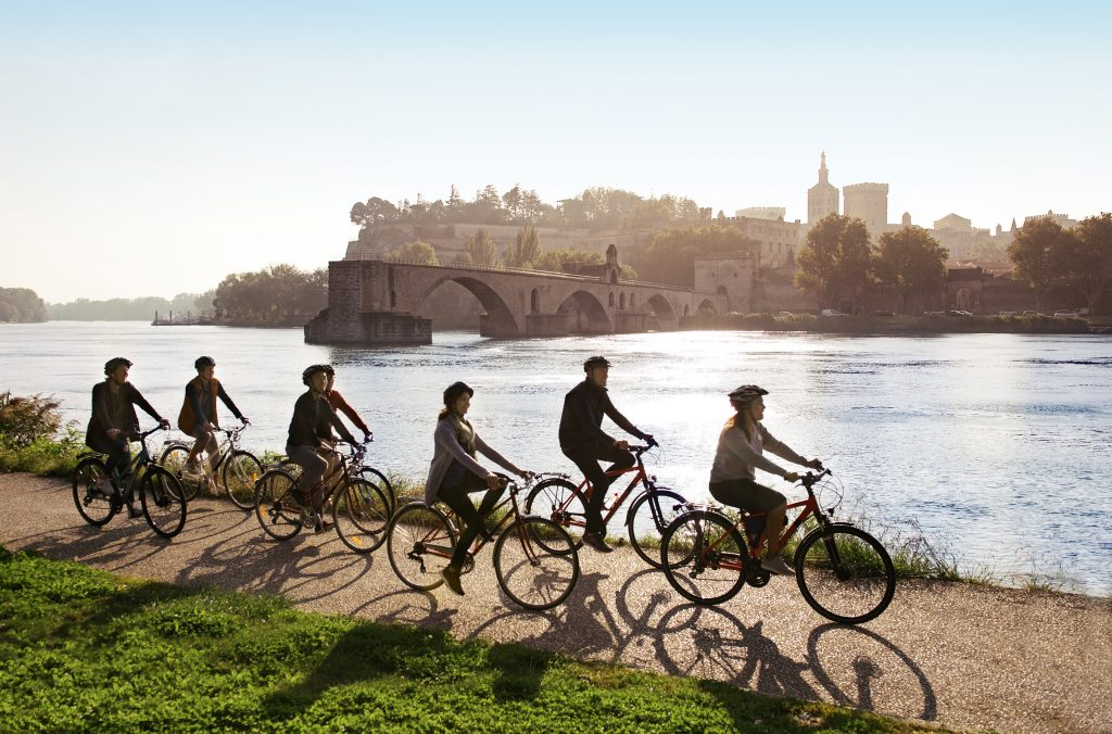 Bike riding along Rhone River shoreline