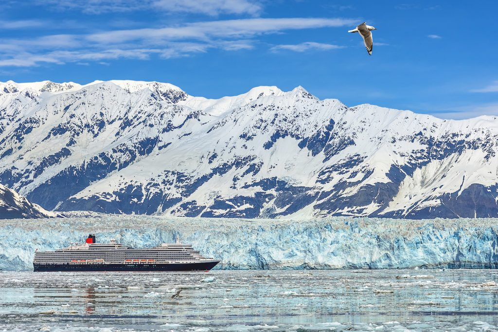 Queen Elizabeth as she crosses in front of Hubbard Glacier in Alaska