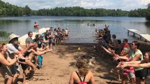 Families compete in Water balloon toss at Camp Nawakwa.