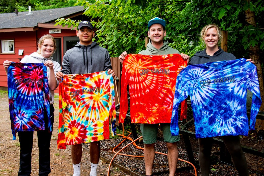Campers display their tie-dye T-shirts at Camp Nawakwa.