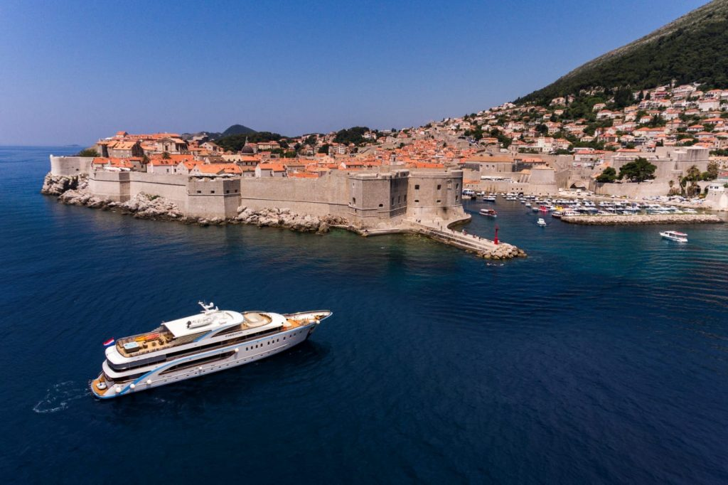 large goolet yacht outside walls of Dubrovnik, one of the best places to sail in the Adriatic Sea.