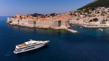 large goolet yacht outside walls of Dubrovnik in Adriatic Sea.