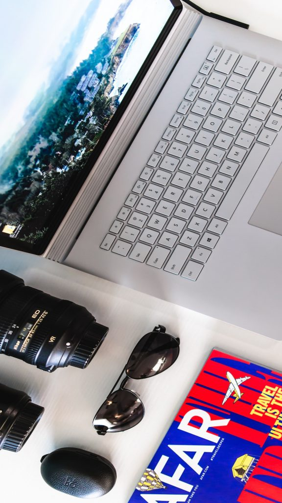 Camera, laptop, travel magazine
